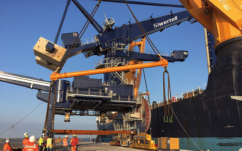 Lift of Siwertell unloader onboard on the vessel