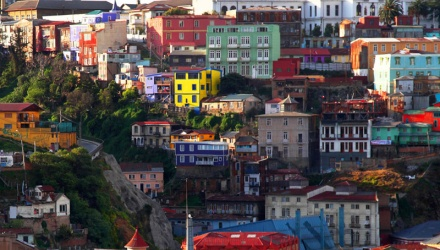 Houses in different bright colours on hill in Valparaiso