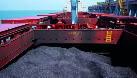 bulk coal in ship hold with screw conveyor unloading ongoing