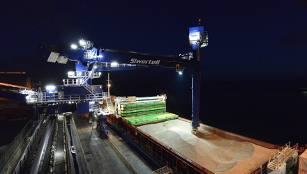 Blue Siwertell Ship unloader in operation at night