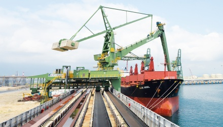 Green Siwertell shipunloader in operation unloading coal from ship in Vietnam