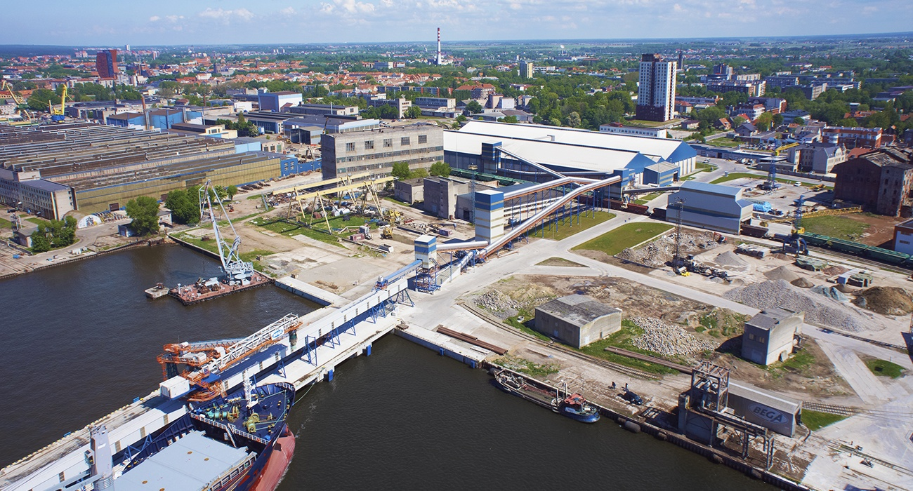 Siwertell bulk terminal with ship loader and conveyors seen from above at Bega in Lithuania